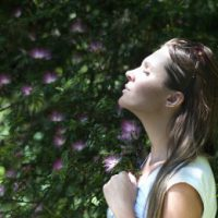 woman breathing deeply to release stress