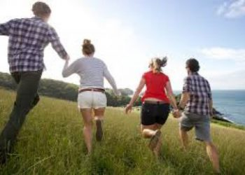 Couples running up mountain depicting first date for singles with anxiety