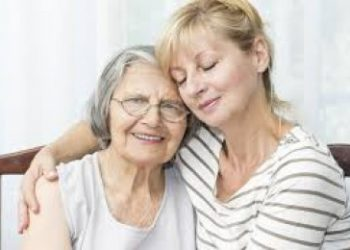 daughter holding elderly mother showing family care