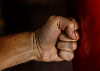 Human fist representing anger displacement
