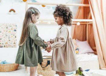 white girl and black girl holding hands